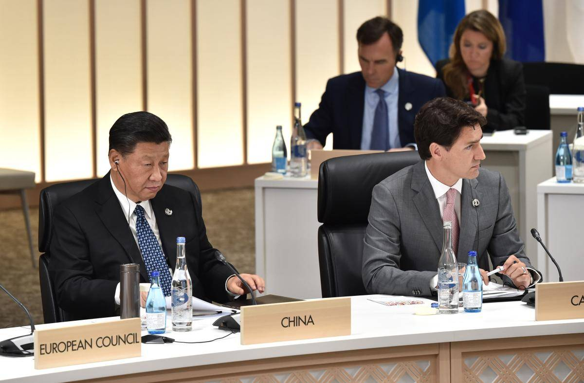 China's President Xi Jinping and Canada's Prime Minister Justin Trudeau attend