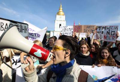 A protester chants slogans on a megaphone during an International Women's Day protest on 8 March 2019 in Kyiv, Ukraine. Photo: Getty Images.