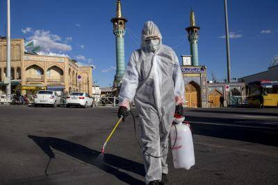 Spraying disinfectant at Tajrish bazaar in Tehran, Iran, during the coronavirus pandemic in March 2020. Photo by Majid Saeedi/Getty Images.