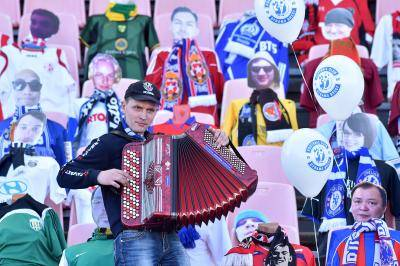Playing accordion in front of dummy football fans in Brest, Belarus as the country's championship continues despite the COVID-19 outbreak. Photo by SERGEI GAPON/AFP via Getty Images.