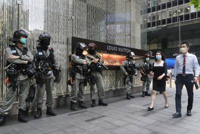 Riot police in front of a luxury goods store in Hong Kong on the day Chinese lawmakers approve a proposal for sweeping new national security legislation in the city. Photo by Roy Liu/Bloomberg via Getty Images.